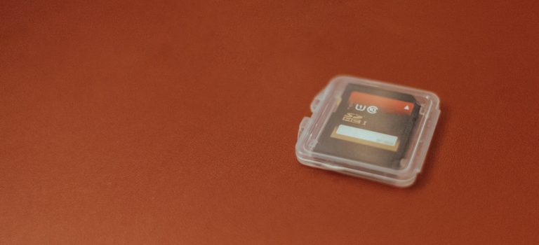 white plastic container on brown surface